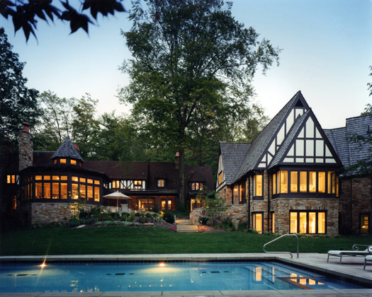 Eastern Suburban Home · Cleveland, Ohio · Dusk shot with poolside view and display of  interior lights and luminescent sky